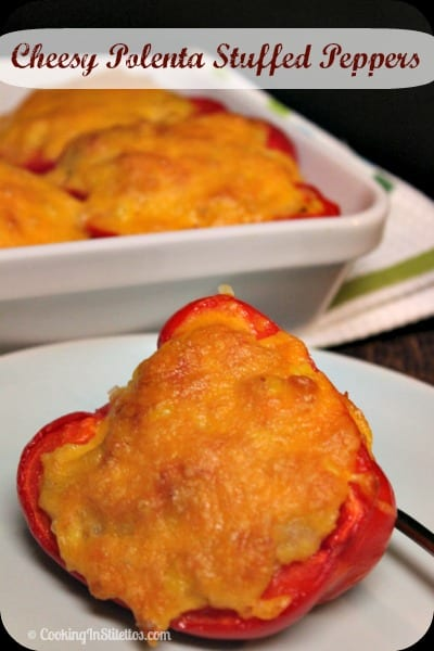 Cheesy Polenta Stuffed Peppers from CookingInStilettos.com are a delicious spin on the classic stuffed peppers with a cheesy corn polenta filling and perfect for Meatless Monday