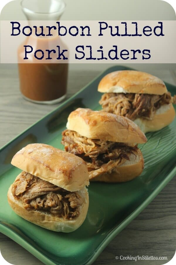 These Bourbon Pulled Pork Sliders from CookingInStilettos.com are simmered in a deliciously rich bourbon barbecue sauce, perfect for your next party, tailgate or just because.  Best part is the slow cooker does most of the work. | @CookInStilettos