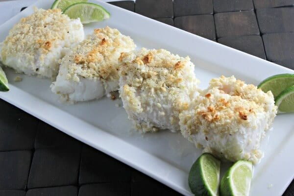 Baked Cod goes from ordinary to extraordinary when it melds with coconut, almonds and a hint of lime. This Coconut Almond Crusted Cod recipe from CookingInStilettos.com will be a family favorite! | Cod Recipes | Coconut | Seafood | Baked Fish | Easy 30 Minute Recipe | Tropical Recipe