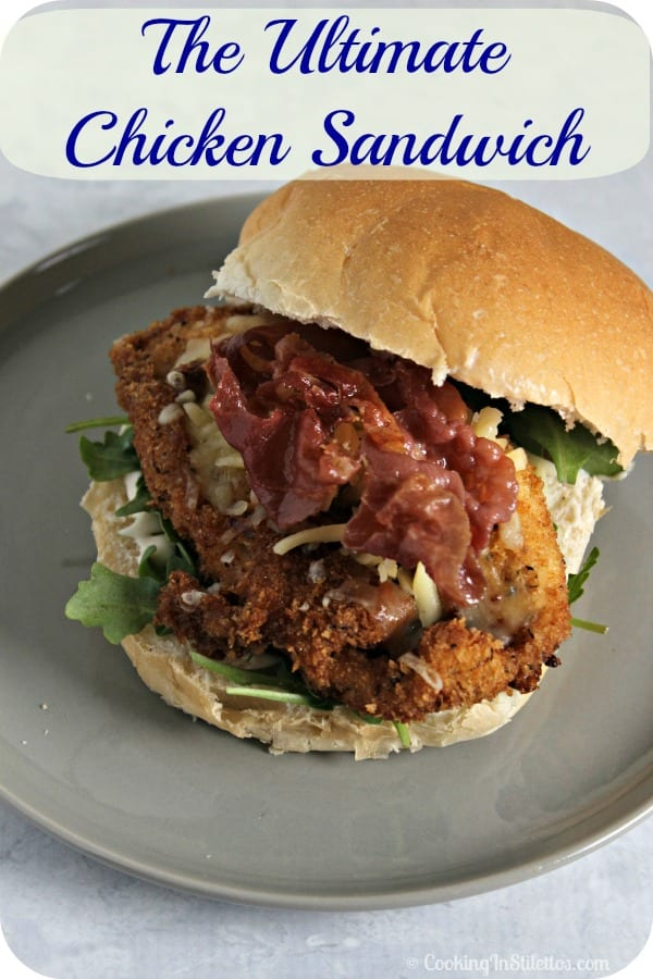 This is the Ultimate Chicken Sandwich - lightly breaded chicken cutlets nestled in a soft bun layered with peppery arugula, crisp prosciutto & melty cheese.  Add a schmear of light mayo and you have a winner of a sandwich! | Cooking In Stilettos