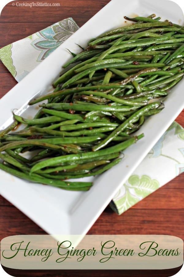These scrumptious Honey Ginger Green Beans from CookingInStilettos.com are the perfect side dish that comes together in a flash. Just a few ingredients come together for a veggie side your family will love! Green Beans | Side Dish | Vegetables | Easy Recipe