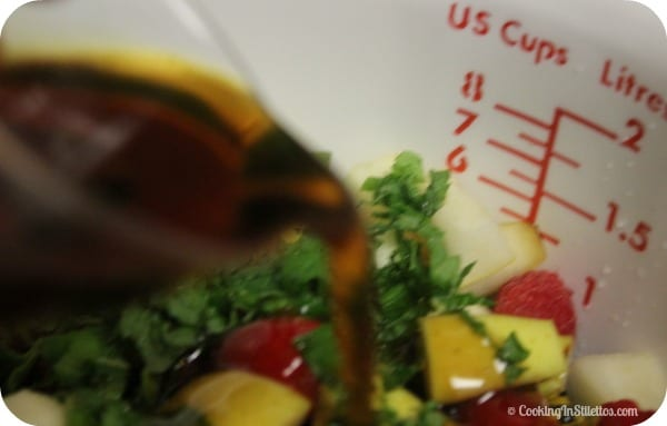 Berry Mint Fruit Salad - Adding the Maple Syrup   Cooking In Stilettos
