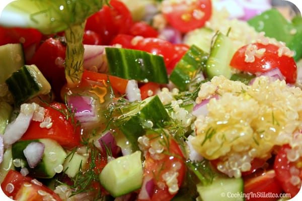 Cucumber Tomato Salad with Quinoa and Ricotta Salata - Adding the Dill Vinaigrette | CookingInStilettos.com
