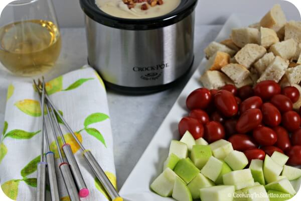 Have a last minute soiree - host a Wine and Easy Cheese Fondue party. This Easy Cheese Fondue from CookingInStilettos.com comes together in minutes. Just Serve with some crisp veggies and toasty bread and you have the makings of a rockin' party | Fondue Recipe | Wine and Cheese | How To Make Cheese Fondue | Fondue Party