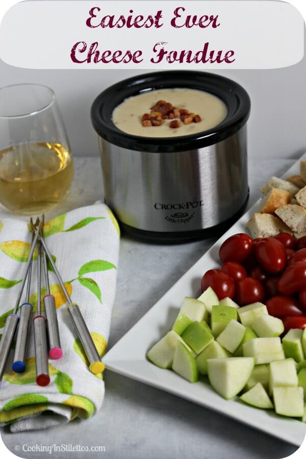 Have a last minute soiree?  Why not have a Wine and Cheese Fondue party.  This easy cheese fondue comes together in minutes.  Serve with some crisp veggies and toasty bread and you have the makings of a rockin' party | Cooking In Stilettos