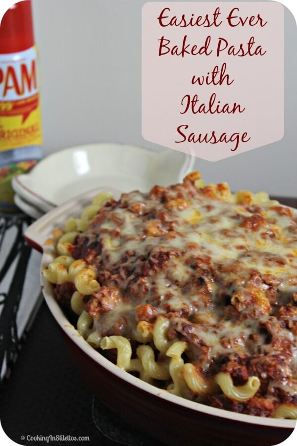 Baked Pasta with Italian Sausage is a comfort food favorite.  Pasta noodles are smothered in a rich meaty sauce studded with Italian sausage and gooey cheese and baked to perfection - don't you want a plate of this now? | Cooking In Stilettos