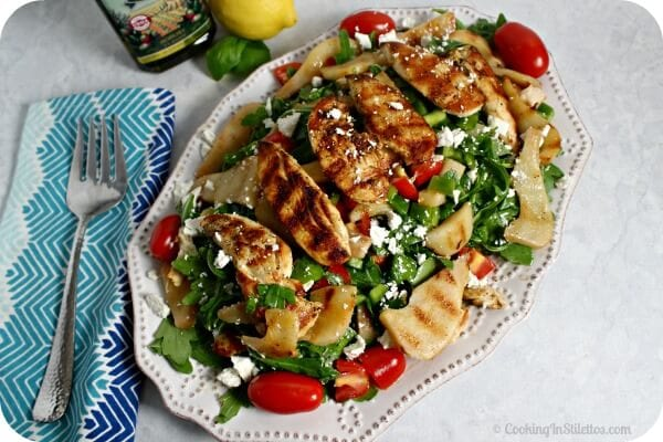 This Grilled Chicken and Pear Salad with Lemon Basil Vinaigrette from CookingInStilettos.com easily has the flavors of summer on a plate. Grilled chicken and juicy pears are accented by peppery arugula and salty ricotta salata and drizzled with a lemon basil vinaigrette. What's not to love!