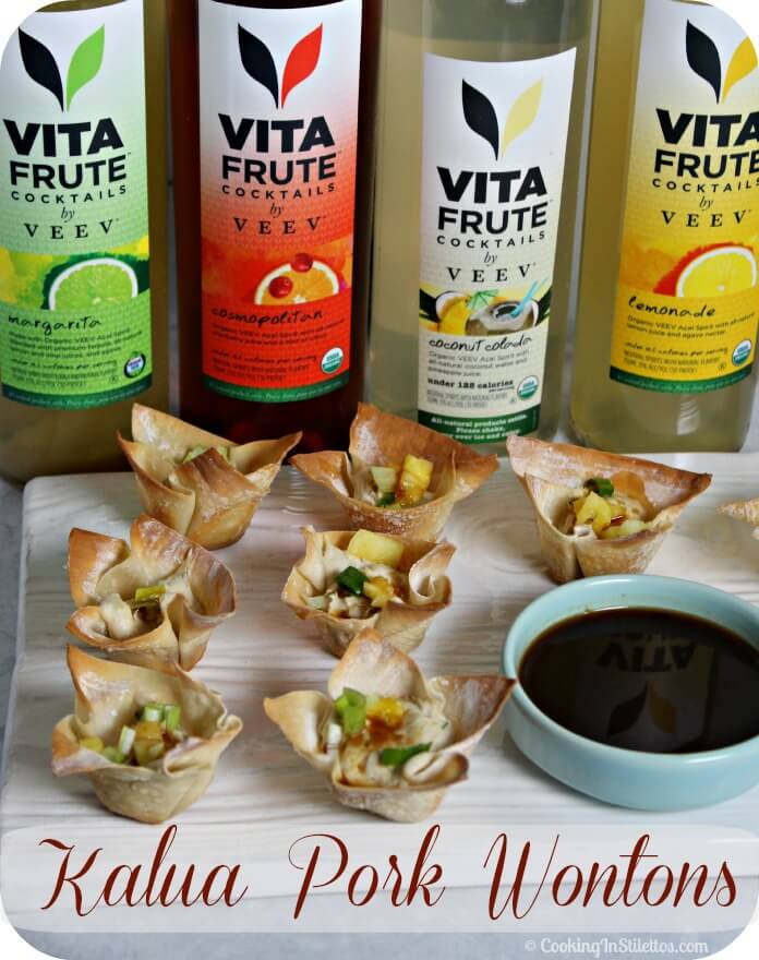Kalua Pork Wontons with Pineapple Teriyaki Sauce are perfect for a party.  Flavorful kalua pork is nestled in a savory creamy filling and baked in little wonton cups.  Serve with a pineapple teriyaki sauce and your guests will go crazy | Cooking In Stilettos