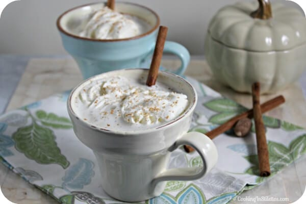 This Bourbon Laced Vanilla Chai Tea Latte from CookingInStilettos.com is the perfect way to unwind from a long day. Black tea is simmered with chai spices and vanilla and then laced with a bit of milk, a touch of bourbon and to take it over the top - whipped cream, a hint of nutmeg and a swizzle of cinnamon. What's not to love? | @CookInStilettos. | #Bourbon #Chai #Tea. | Made from Scratch | Homemade | Hot Chai Latte | Cocktail | Drink | Boozy Sips
