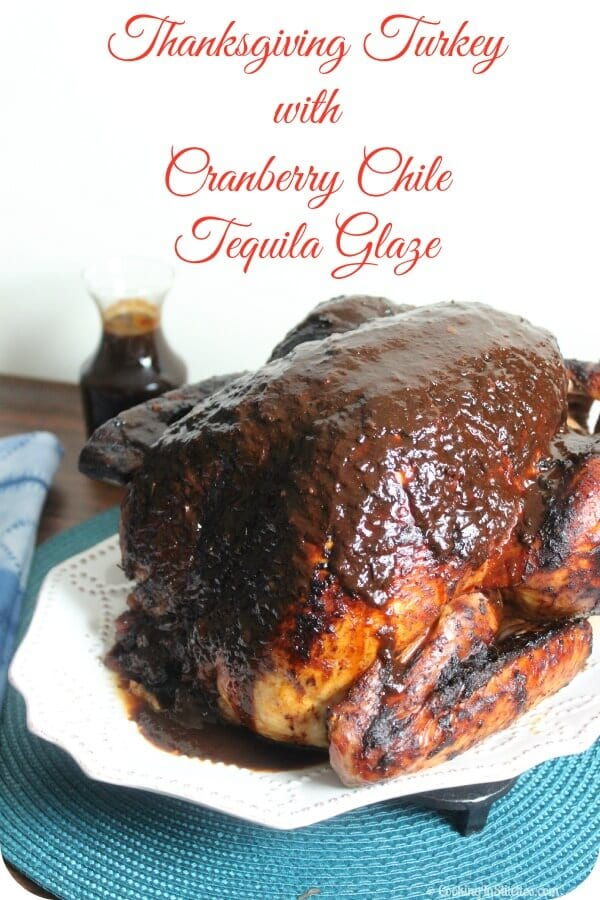 This Thanksgiving Turkey with Cranberry Chile Tequila Glaze from CookingInStilettos.com is the ultimate Thanksgiving turkey - spicy, sweet and packed with flavor thanks to a rich cranberry chile tequila glaze.