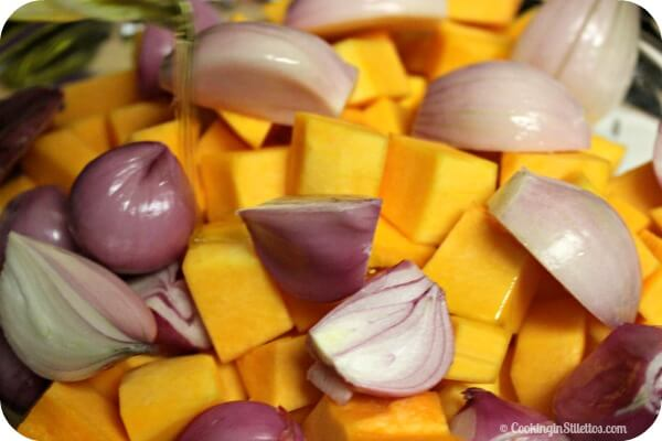 Roasted Butternut Squash with Pecans, Shallots & Blue Cheese - Adding the Oil | CookingInStilettos.com