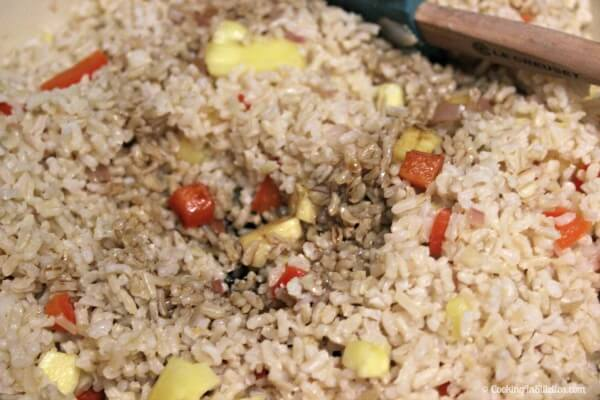 Aloha Fried Rice - Adding the Rice and a Drizzle of Soy | Cooking In Stilettos