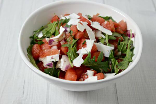 This Watermelon Salad with Ricotta Salata from CookingInStilettos.com will be a summer favorite - fresh sweet summer watermelon is tossed with peppery arugula, sharp red onion, a touch of lime and shavings of fresh salty ricotta salata.   Watermelon   Salad   Summer   Sweet   Savory   Arugula Salad   Ricotta Salata