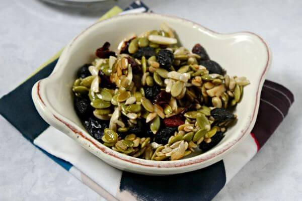 This Pumpkin Seed Cherry Trail Mix from CookingInStilettos.com is way more addictive than pistachios. Pumpkin seeds and nuts tossed with dried cherries and cranberries with a touch of sweetness - it's a snack you can feel good about | @CookInStilettos