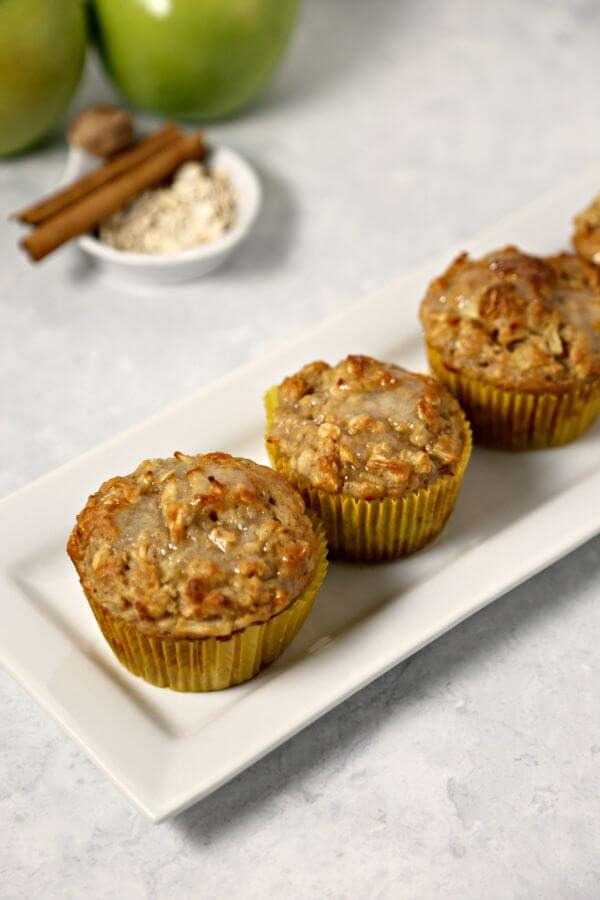 Apple Oatmeal Muffins from CookingInStilettos.com are perfect for fall - tart crisp Granny Smith apples are folded into moist and delicious oatmeal muffins and drizzled with a sweet applesauce glaze. | Apple Oatmeal Muffin | Oatmeal Muffins | Spiced Apple Muffin | Granny Smith Apples | Oatmeal | Applesauce | Fall Breakfast Recipes | Fall Baking | Easy Muffin Recipe | Breakfast | Brunch
