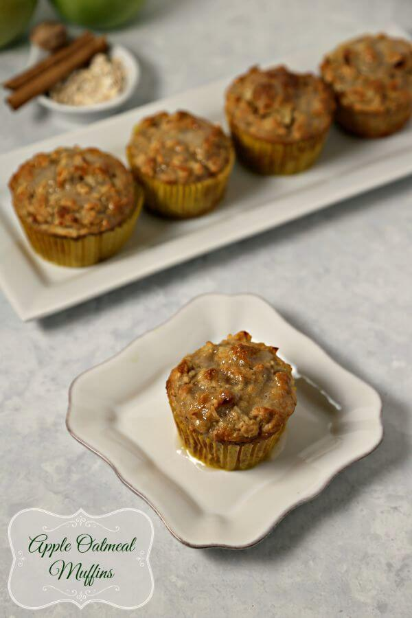 Apple Oatmeal Muffins are perfect for fall - tart crisp Granny Smith apples are folded into moist and delicious oatmeal muffins and drizzled with a sweet applesauce glaze. You are going to want these for breakfast | Cooking In Stilettos