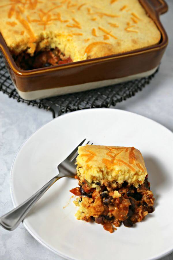 This Easy Chipotle Tamale Pie from CookingInStilettos.com is comfort food with a bit of sass. Lean ground turkey, tomatoes & spices are nestled under a cheesy cornbread crust and baked to perfection. Tamale Pie | Comfort Food | Mexican | Turkey | Healthy Recipe