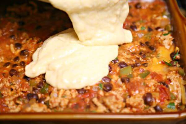 Easy Chipotle Tamale Pie - Adding the Batter | Cooking In Stilettos