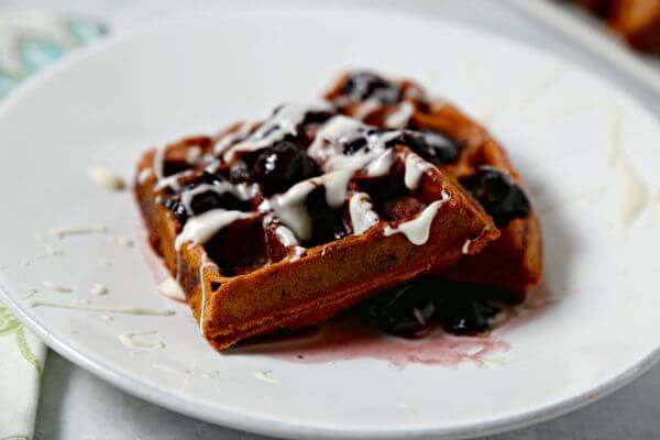 Red Velvet Waffles with Bourbon Cherry Syrup and Cream Cheese Drizzle | Cooking In Stilettos