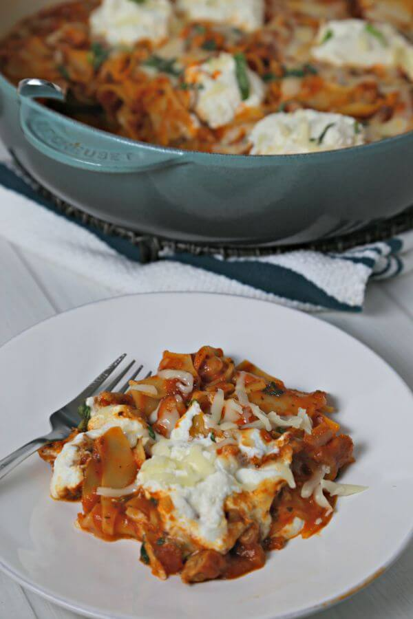 This Rustic Skillet Lasagna from CookingInStilettos.com is a delicious and easy weeknight dinner idea. This skillet lasagna recipe goes from stovetop to table in about 30 minutes | Skillet Lasagna | One Pot Meal | 30 Minute Meal | Easy Weeknight Recipe | Easy Pasta Recipe | Dinner Made Easy