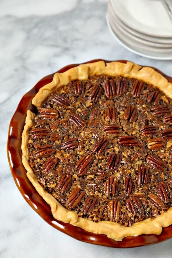 Chocolate Bourbon Pecan Pie from CookingInStilettos.com is a delicious dessert for your holiday table. Dark chocolate melds with sugar, pecans and a hint of bourbon for the ultimate pecan pie recipe. Pecan Pie | Bourbon Pecan Pie | Baking with Bourbon | Chocolate Pecan Pie | Holiday Dessert | Holiday Pie | #pecanpie #chocolate #bourbon