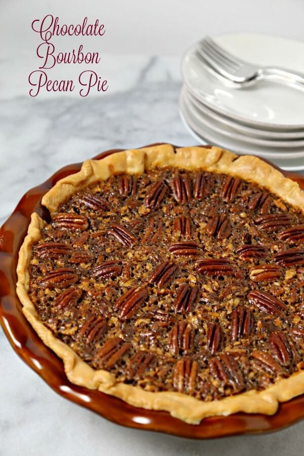 Chocolate Bourbon Pecan Pie from CookingInStilettos.com is a delicious dessert for your holiday table. Dark chocolate melds with sugar, pecans and a hint of bourbon - what's not to love? #BloggerCLUE