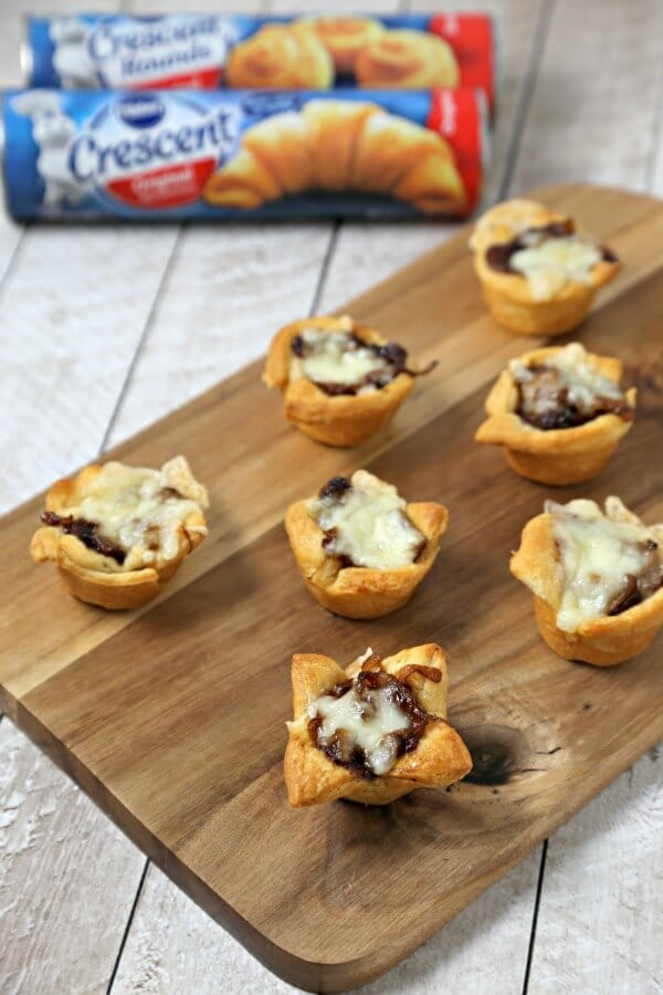 French Onion Bites from CookingInStilettos.com have the flavors of the classic soup in a chic appetizer. Buttery Pillsbury Crescent Roll dough is baked with richly caramelized onions and savory fontina cheese. | Appetizer | Caramelized Onions | French Onion Soup | Chic Appetizer | Comfort Food Recipe | Easy Entertaining