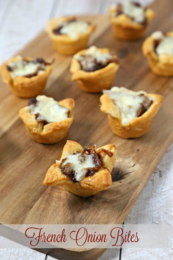 French Onion Bites from CookingInStilettos.com has the flavors of the classic soup in a chic appetizer. Buttery Pillsbury Crescent Roll dough is baked with richly caramelized onions and savory fontina cheese. How easy is that? #Pillsbury