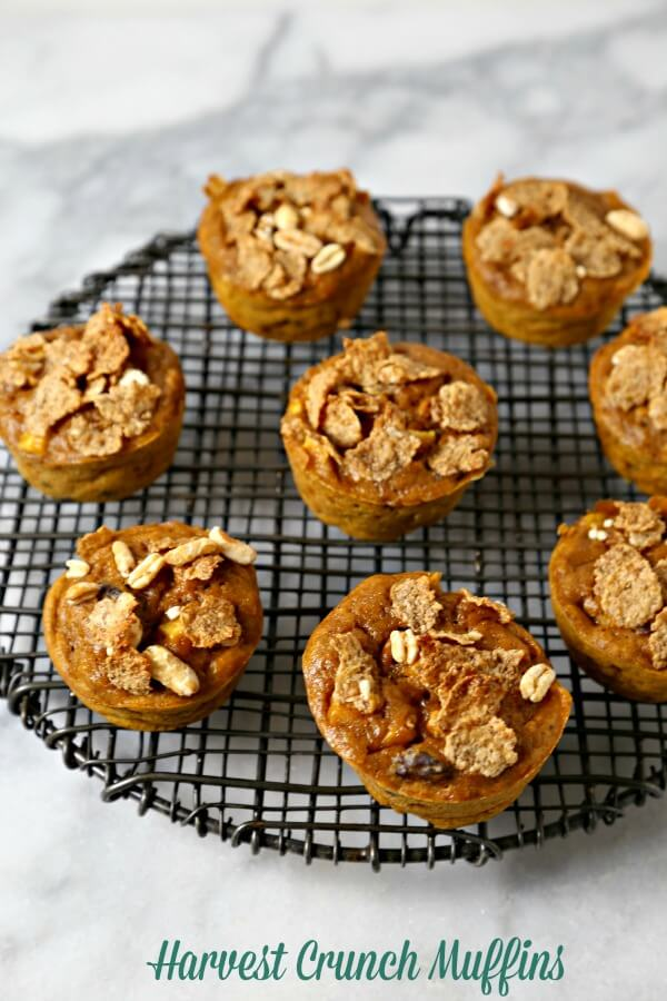 Harvest Crunch Muffins from CookingInStilettos.com are a delicious breakfast on the go.  Harvest flavors like pumpkin, apples and cranberries are baked with spices and a bit of crunch from Kellogg's Origins Ancient Grains Blend Cereal for the perfect muffin