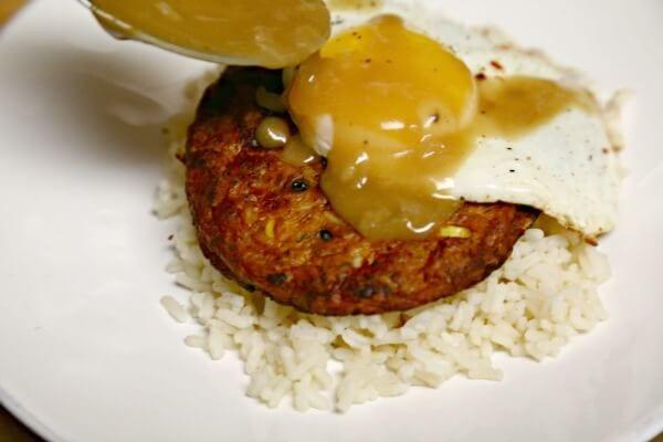 Meatless Loco Moco with Savory Onion Gravy - Assembling the Loco Moco | CookingInStilettos.com