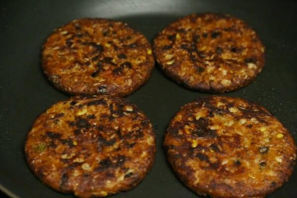 Meatless Loco Moco with Savory Onion Gravy - Browning the Veggie Burgers | CookingInStilettos.com