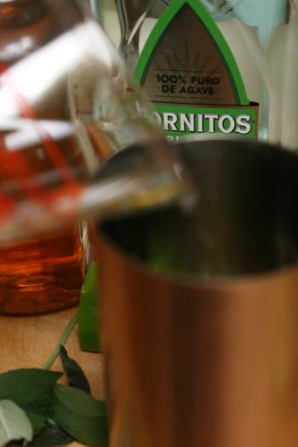 Tequila Cider Smash - Adding the Tequila   CookingInStilettos.com