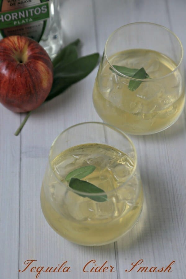 Toast the holiday season with this Tequila Cider Smash from CookingInStilettos.com. Silver tequila, apple cider and fresh sage are muddled into the perfect sip for the holidays!