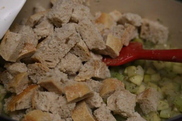 Thanksgiving Stuffing Recipe - Folding in the Bread | CookingInStilettos.com