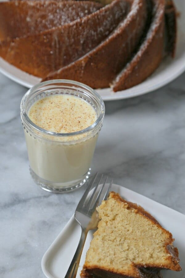 Bourbon Soaked Eggnog Cake from CookingInStilettos.com is a dessert showstopper. A moist rich eggnog cake with hints of spice and bourbon and drizzled with a bourbon eggnog glaze.