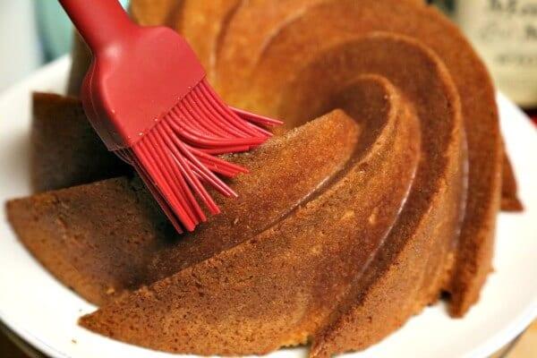 Bourbon Soaked Eggnog Cake - Soaking with Bourbon   CookingInStilettos.com
