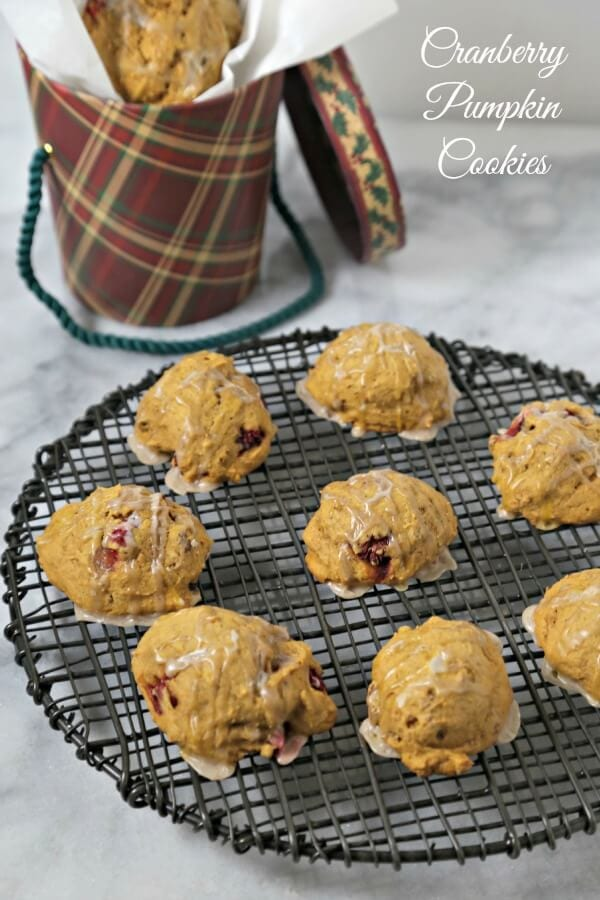 These Festive Cranberry Pumpkin Cookies from CookingInStilettos.com are studded with pecans and fresh cranberries and drizzled with a sweetly spiced glaze. These delicious cookies will be a cookie jar favorite!