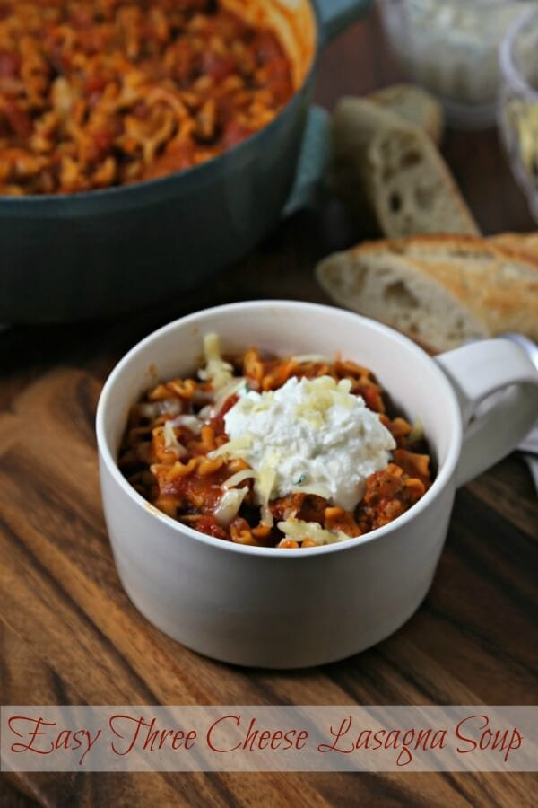 Easy Three Cheese Lasagna Soup from CookingInStilettos.com is packed with lasagna flavor and is ready in about 30 minutes - perfect for a quick weeknight dinner!