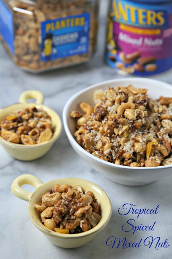 These Tropical Spiced Mixed Nuts made with a variety of Planters nuts coated in a sweetly spicy glaze and tossed with tropical flavors is a delicious gift to serve this holiday season. #PlantersHoliday #CleverGirls #Sponsored