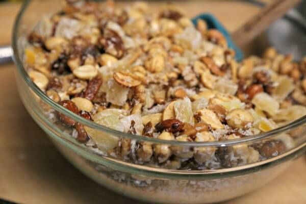 Tropical Spiced Mixed Nuts - Mixing | CookingInStilettos.com