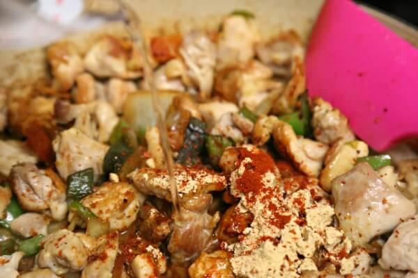 Chicken Fajita Queso Fundido - Simmering with Spices   CookingInStilettos.com