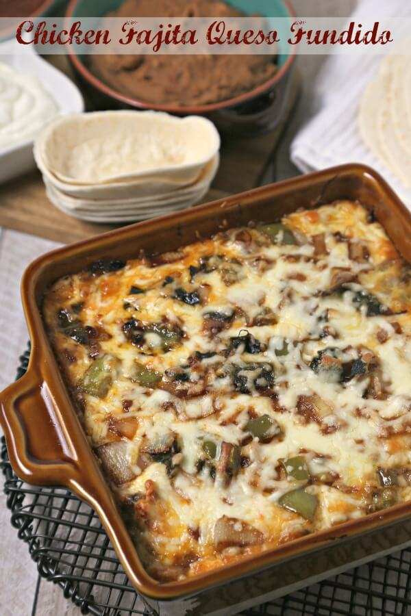 Chicken Fajita Queso Fundido from CookingInStilettos.com is perfect for game day. Spiced tender chicken, roasted poblano peppers and sweet onions are baked with layers of cheese until molten and bubbly. Serve with soft Old El Paso tortillas and you will have a winning dish!