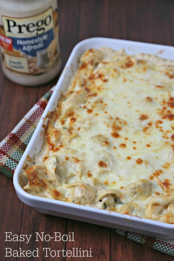 This Easy No-Boil Baked Tortellini from CookingInStilettos.com comes together in a flash. Refrigerated tortellini is tossed with a cheesy alfredo sauce and then baked to perfection under layers of smoked mozzarella cheese. This is comfort in every bite!