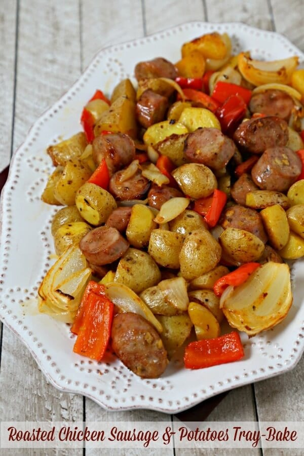 This Roasted Chicken Sausage and Potatoes Tray Bake from CookingInStilettos.com is a delicious and quick easy weeknight dinner. Your favorite chicken sausage is tossed with potatoes, onions and peppers with a hint of spice and roasted to perfection all on a sheet pan. How easy is that? | Sausage and Onions | Easy Weeknight Dinner | Tray Bake Recipe | Sheet Pan Dinner | Sheet Pan Recipe |