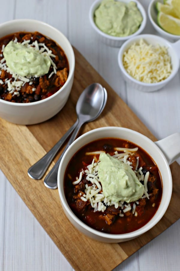 Baja Chicken Chili from CookingInStilettos.com is ready in 30 minutes and tastes like it has simmered for hours. Southwestern flavors, spices & a hint of honey unite for the perfect chicken chili recipe. | @CookInStilettos