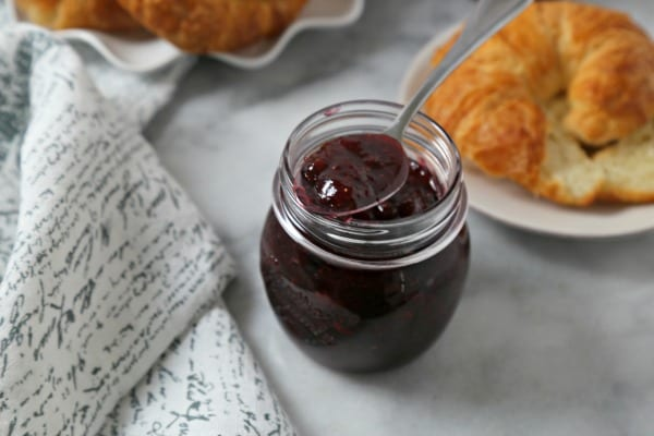 This Easiest Ever Strawberry Jam recipe from CookingInStilettos.com is perfect for brunch this weekend with just a few ingredients for a delicious fresh tasting strawberry jam! | Strawberry Jam | Refrigerator Jam | Freezer Jam | Strawberries | Made from Scratch