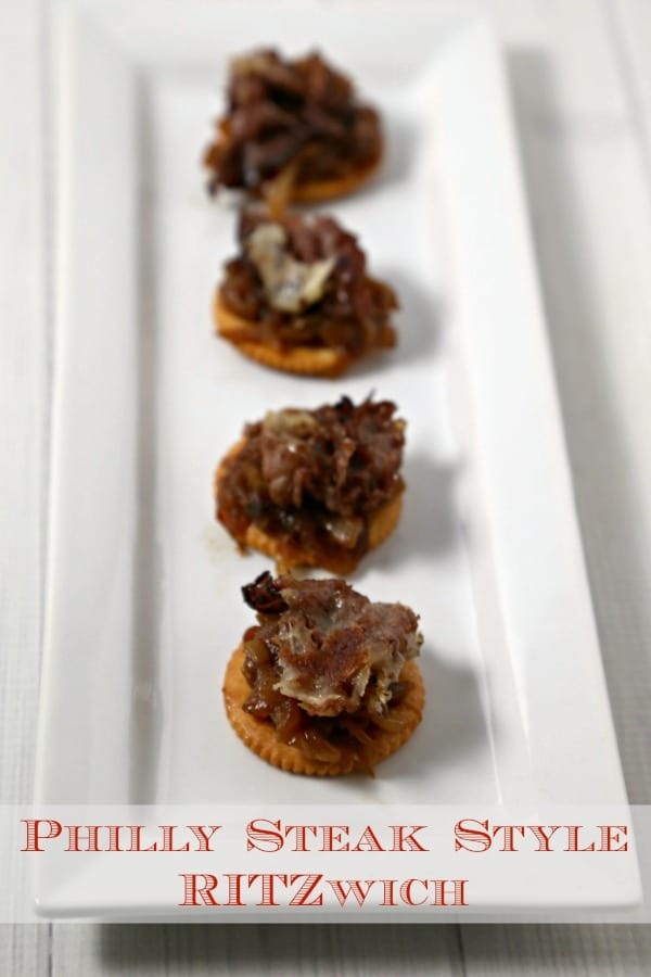 This Philly Steak Style RITZwich from CookingInStilettos.com is a hearty bite with London broil, melted provolone & caramelized onions nestled on a rich buttery RITZ cracker   @CookInStilettos