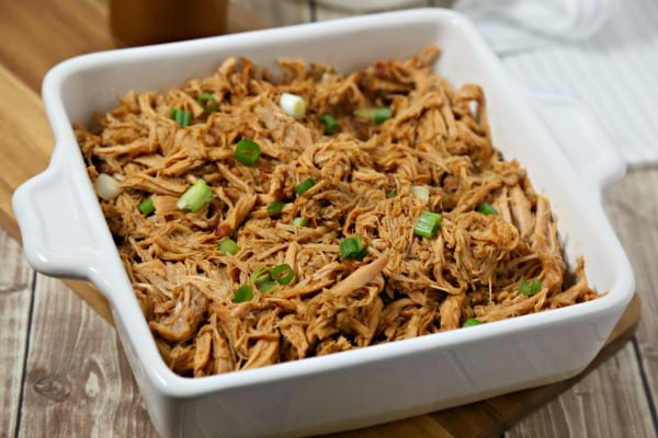This Bourbon Slow Cooked Pulled Pork from CookingInStilettos.com will be your absolute favorite pulled pork recipe. Tender pork is slow cooked for hours in a rich smoky bourbon sauce and couldn't be easier to make. | Pulled Pork Recipe | Slow Cooker Recipe | Crock Pot | Cooking with Bourbon | Bourbon BBQ Sauce