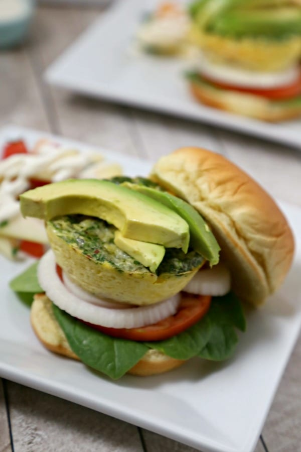 "This Cheesy Breakfast Burger from CookingInStilettos.com is soon to be your favorite brunch recipe. A light as a feather quiche ""burger"" is nestled among fresh veggies in a pillowy bun for the perfect bite. 