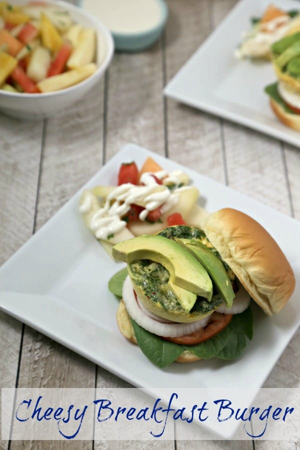 """This Cheesy Breakfast Burger from CookingInStilettos.com is soon to be your favorite brunch recipe. A light as a feather quiche """"burger"""" is nestled among fresh veggies in a pillowy bun for the perfect bite.   @CookInStilettos"""